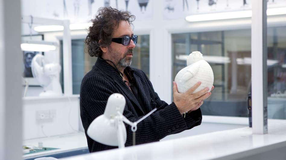 Tim Burton, seen here with a stop-motion puppet, has made several films using the time-intensive style, including The Nightmare Before Christmas, Corpse Bride and his latest film, Frankenweenie. (Walt Disney Pictures)