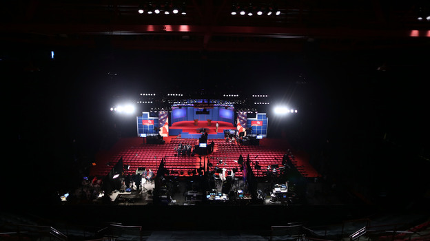 Workers prepare Wednesday for the presidential debate at the University of Denver. Experts differ over whether even a televised debate is a good forum for sharing very specific details about policy proposals. (Getty Images)