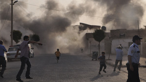 Smoke rises after artillery fire  from nearby Syria hits the Turkish border town of  Akcakale. Turkey said five of its citizens were killed and that it responded by firing on targets in northern Syria. The episode raised tensions on the already volatile border region.