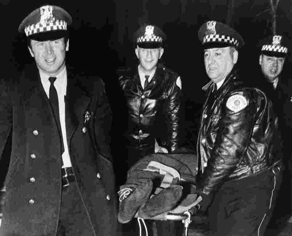 Chicago police remove the body of Fred Hampton, leader of the Illinois Black Panther Party, who was slain in a gunbattle with police in Chicago on Dec. 4, 1969, when police tried to search the group's office. Hampton was one of several Black Panthers who were killed in shootouts with police.