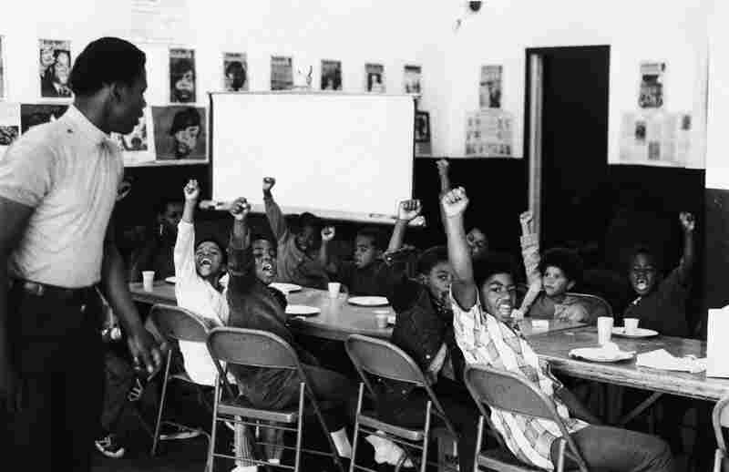 "The Panthers also ran a number of social service programs in cities across the country, including free breakfasts for students, health clinics and schools. Here, students give the black power salute at a San Francisco Black Panther ""liberation school"" in 1969."