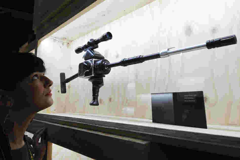 "The ""Hasselblad Gun"" used in Licence to Kill, on display in an exhibition entitled Designing 007: Fifty Years of Bond Style at the Barbican in London."