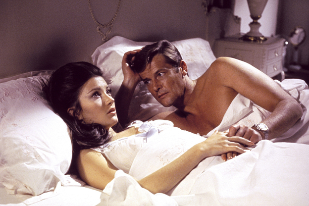 A scene from 1973's Live and Let Die features Jane Seymour and Roger Moore. In the film, Moore wears a supermagnetic wristwatch said to deflect bullets at long range. (AP)