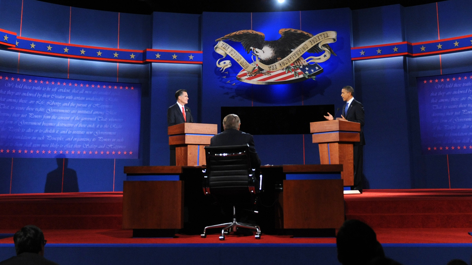 President Obama and Republican presidential candidate Mitt Romney participate in the first presidential debate at Magness Arena at the University of Denver on Wednesdasy, moderated by Jim Lehrer of the PBS NewsHour.