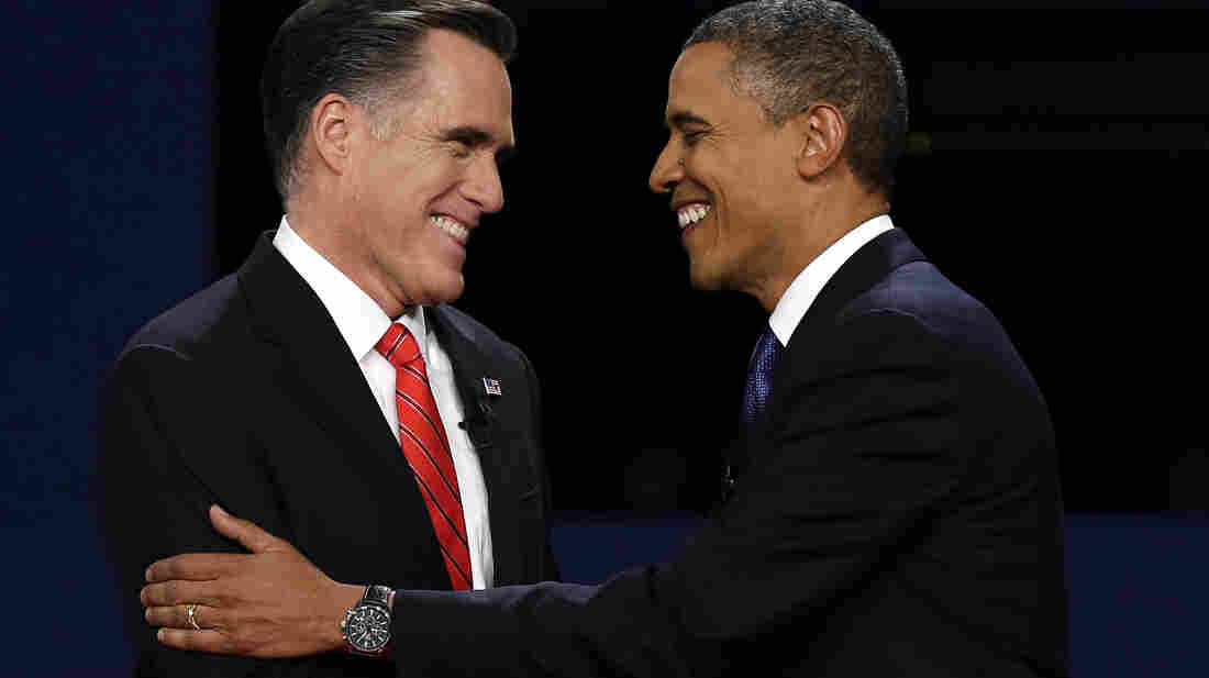 Republican presidential nominee Mitt Romney and President Barack Obama shake hands at the first presidential debate at the University of Denver, Wednesday.