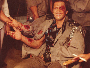 Arnold Schwarzenegger in the makeup trailer for Terminator, getting his do-it-yourself forearm.