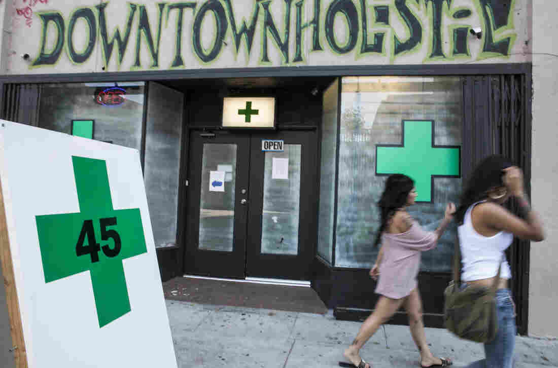 Pedestrians pass a medical marijuana dispensary in the Echo Park area of Los Angeles on July 24, 2012.