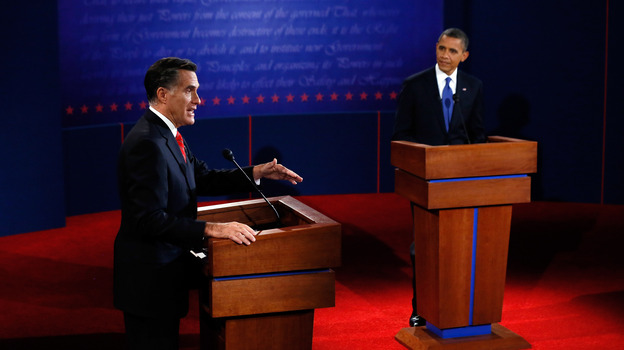 Mitt Romney makes his point as President Obama listens during Wednesday's debate in Denver. (Getty Images)