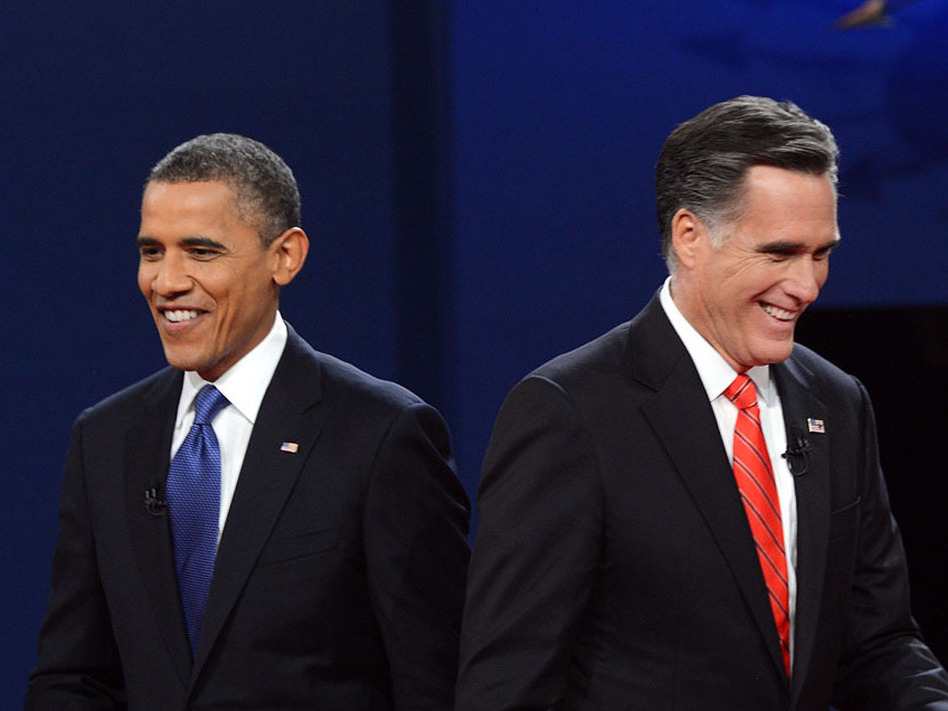 President Obama and Republican presidential candidate Mitt Romney finish their debate at the University of Denver on Wednesday.