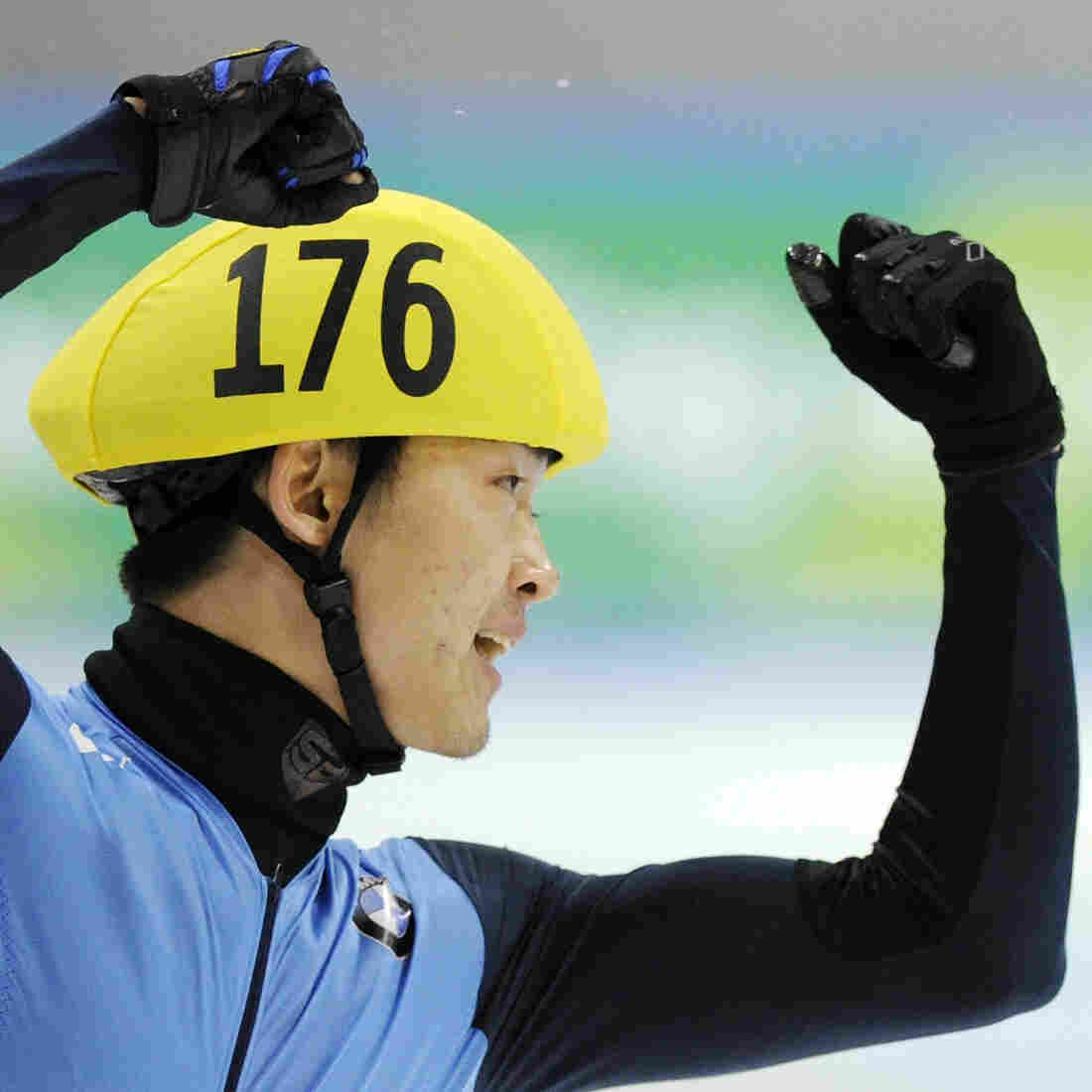 Simon Cho of the U.S. celebrates during the 500 meter men's final race at the Short Track Speed Skating World Cup in Dresden in 2011.
