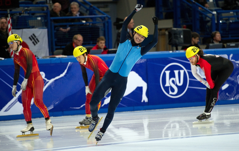 Simon Cho (center) celebrates after beating China's Liang Wenhao and Liu Xianwei and Canada's Olivier Jean (right) in the men's 500-meter final at the 2011 World Short Track Speed Skating Championships in England. (AFP/Getty Images)