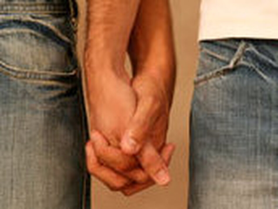 Men holding hands.