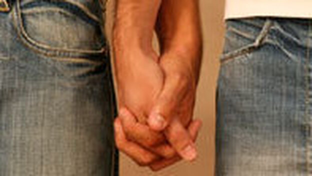 Men holding hands. (iStockphoto.com)