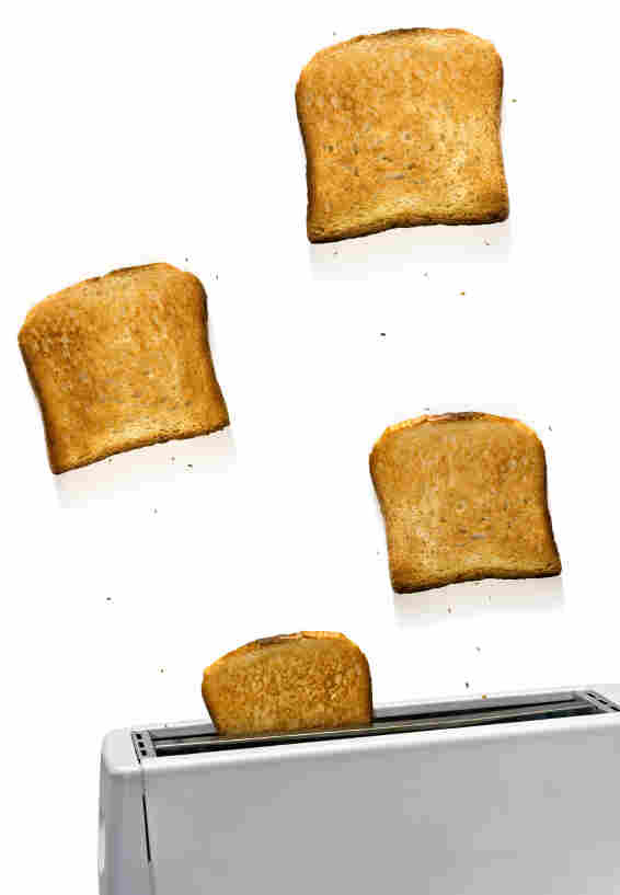 Toasts flying out of toaster.