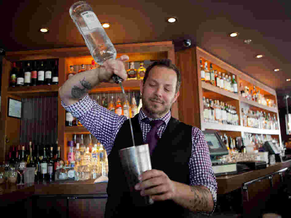 Bar Dupont bartender Brian Collins pours us a cold one.