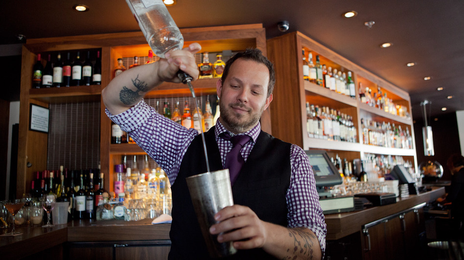 Bar Dupont bartender Brian Collins pours us a cold one. (NPR)
