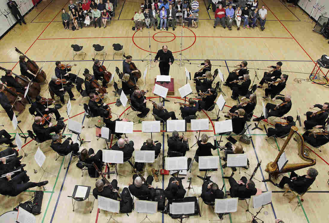 Locked out musicians of the Minnesota Orchestra perform in a free event in a gym in Minneapolis.