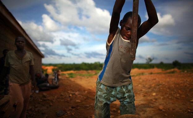 A young boy works at an illegal gold mine in Dareta, Nigeria.