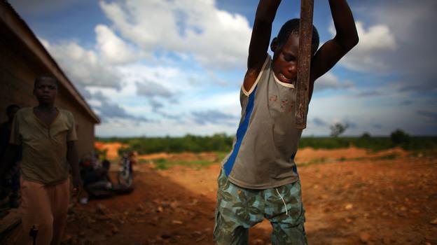 A young boy works at an illegal gold mine in Dareta, Nigeria. (NPR)