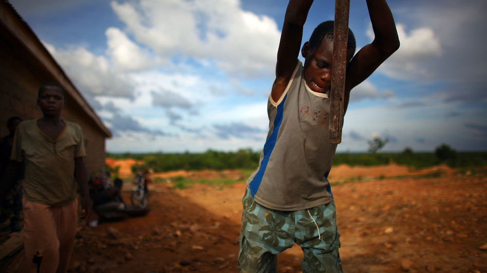 A young boy works at an illegal gold mine in Dareta, Nigeria. (NPR)