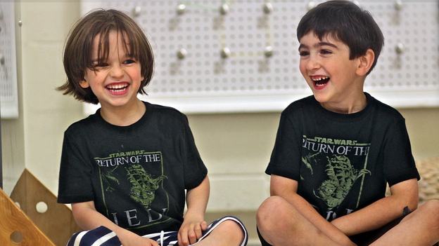 """Ben Blier (left) and his friend Jesse Bleckner hang out in their Yoda T-shirts. On his first day of kindergarten, Ben wore a Yoda T-shirt with """"Go to Kindergarten I Must"""" printed on the front and """"Learn Things I Will"""" on the back. (Courtesy of Nancy Edson)"""