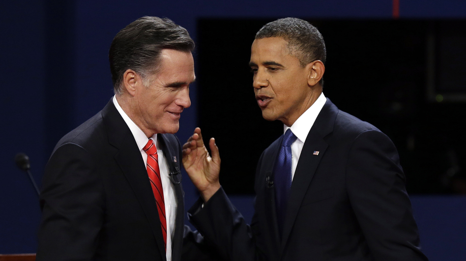 Republican presidential nominee Mitt Romney and President Obama talk after the first presidential debate at the University of Denver on Wednesday. (AP)