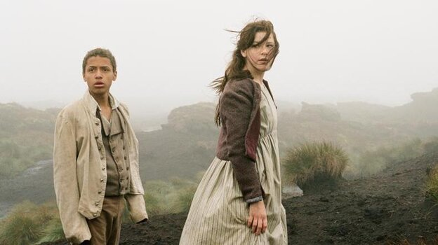 Young Heathcliff (Solomon Glave) and Young Catherine (Shannon Beer) grow up to be an iconic, romantically doomed couple in Wuthering Heights.