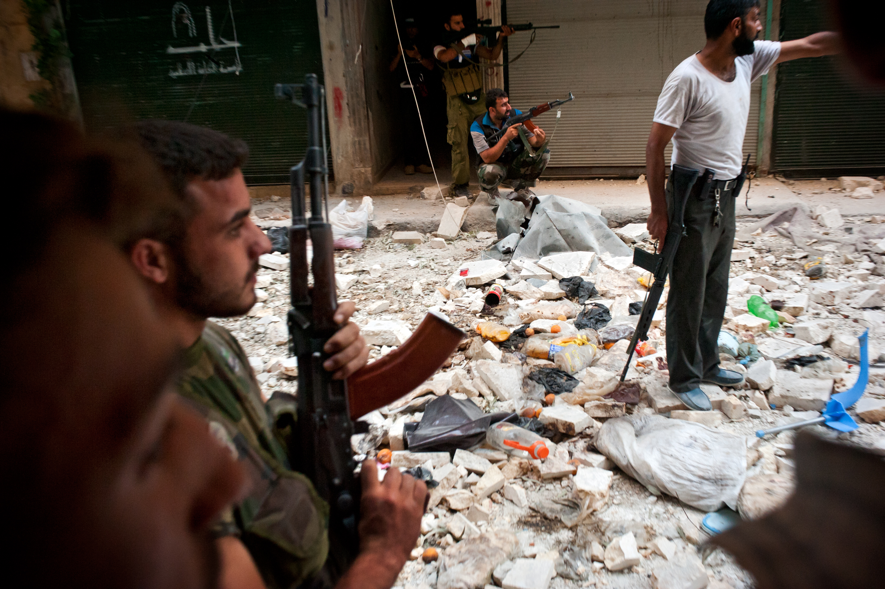 Free Syrian Army fighters take position in the Salah Al Din neighborhood of Aleppo, Aug. 22.