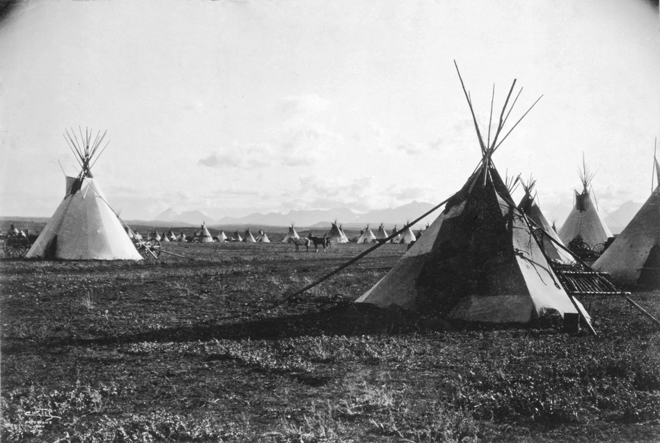 Piegan Camp, 1900. This was the first time Curtis had seen an entire Indian community intact and vibrant. He was enthralled. (Library of Congress)
