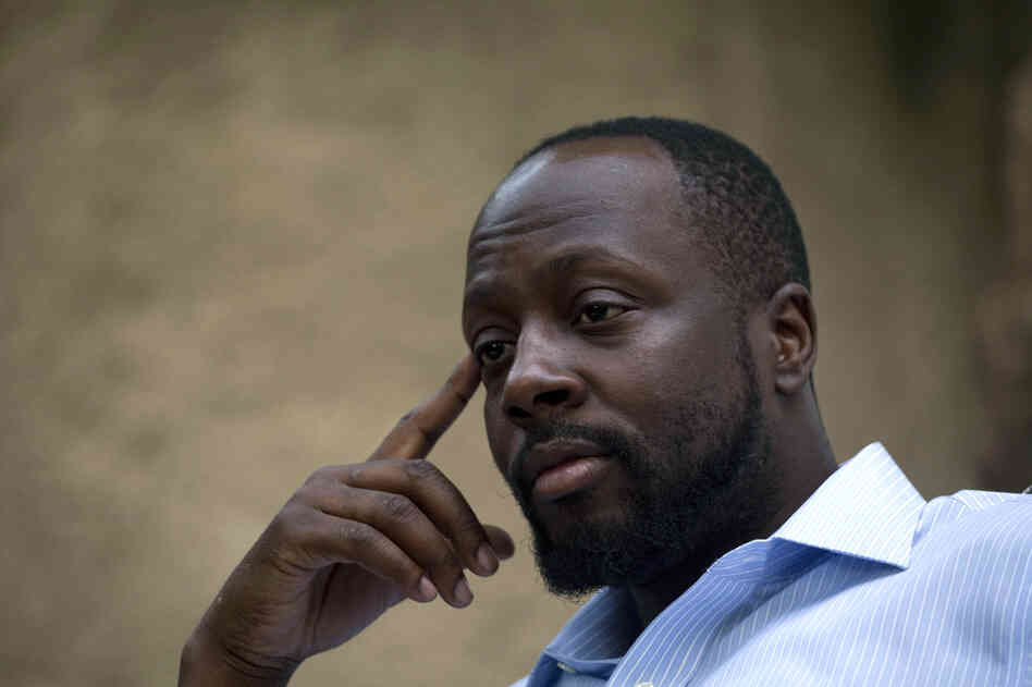 In this Aug. 18, 2010 file photo, Haiti's presidential candidate and hip hop singer Wyclef Jean, speaks during an interview at his mother's house in Croix de Bouquets, Haiti. (AP Photo/Ramon Espinosa, file)
