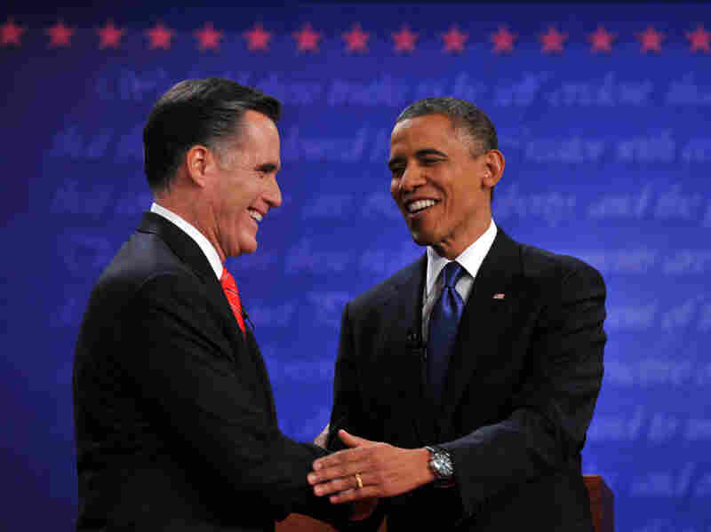 President Obama and Republican Mitt Romney shake hands following their first debate at the University of Denver on Oct. 3.
