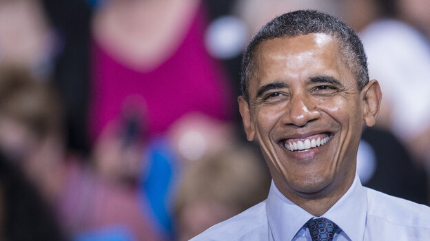 President Obama smiles during a rally Friday at George Mason University in Fairfax, Va. (AFP/Getty Images)