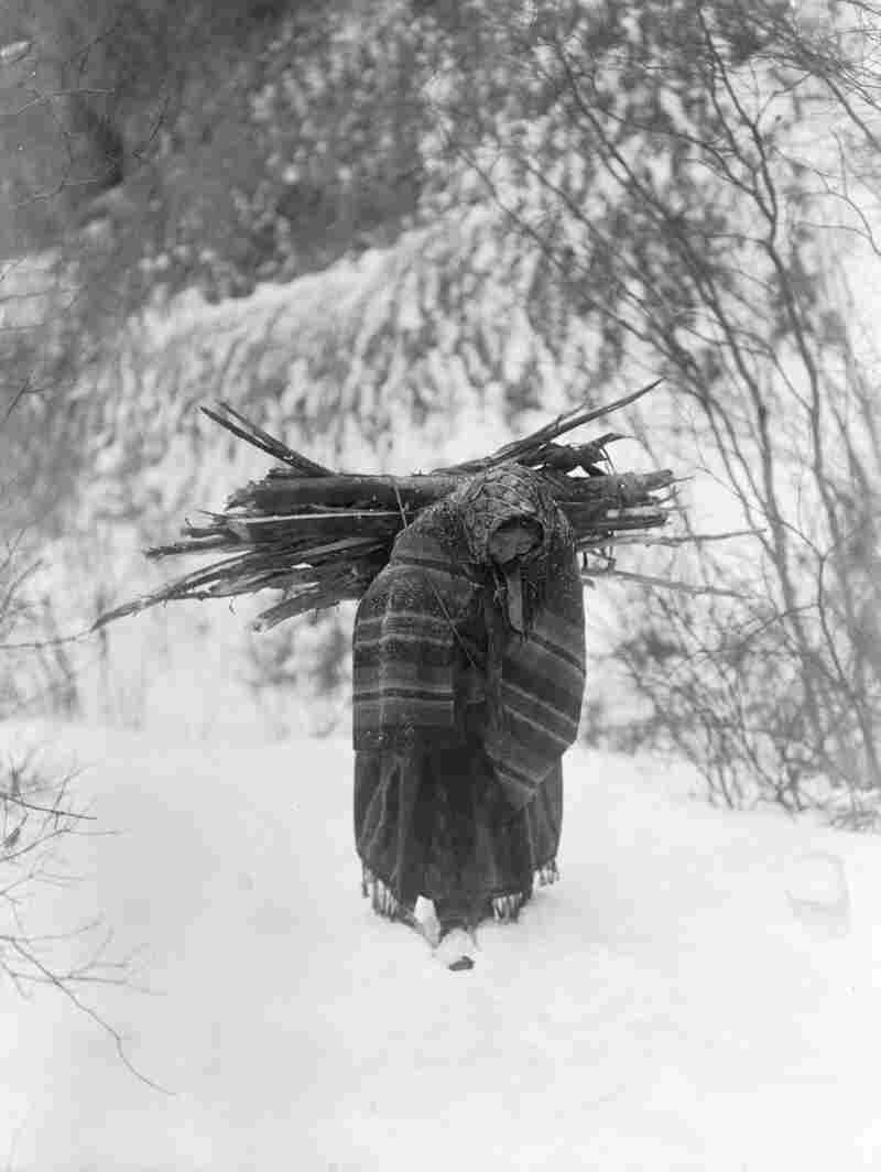 A Heavy Load—Sioux, 1908. Curtis tried to record scenes of the hard life of a winter on the northern plains.