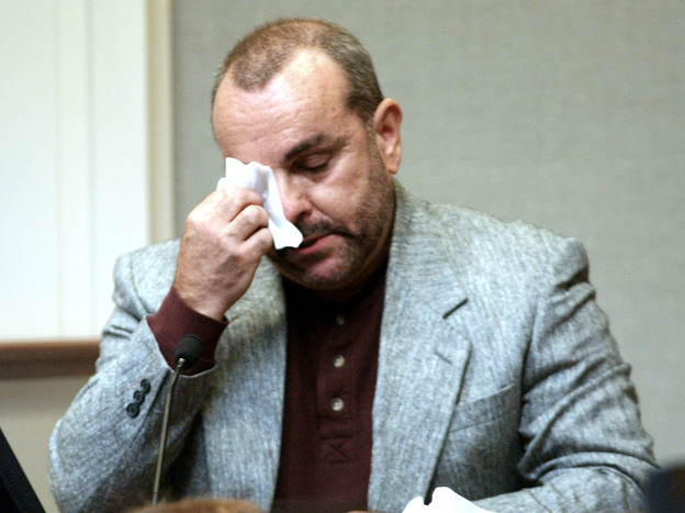 Paul LaRuffa wipes his eyes during John Allen Muhammad's Virginia trial as he describes being shot on Sept. 5, 2002. LaRuffa was shot five times by Muhammad's accomplice, 17-year-old Lee Boyd Malvo. (Getty Images)