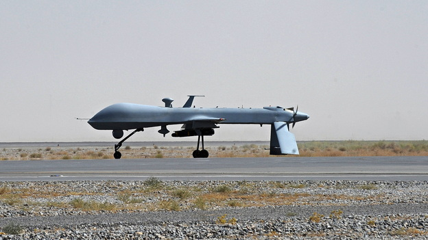 An unmanned U.S. Predator drone sits on the tarmac of Kandahar military airport in southern Afghanistan in 2010. The U.S. has been using drones in Pakistan for years. The Pakistanis initially claimed the drone attacks as the work of their own military, but the strikes have become a source of friction. (AP)