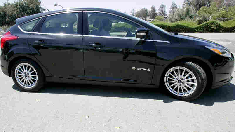 The Obama administration has set higher fuel economy standards for cars and promoted alternative energy sources. Here, a Ford Focus electric car is shown during a test drive in San Jose, Calif., in July.