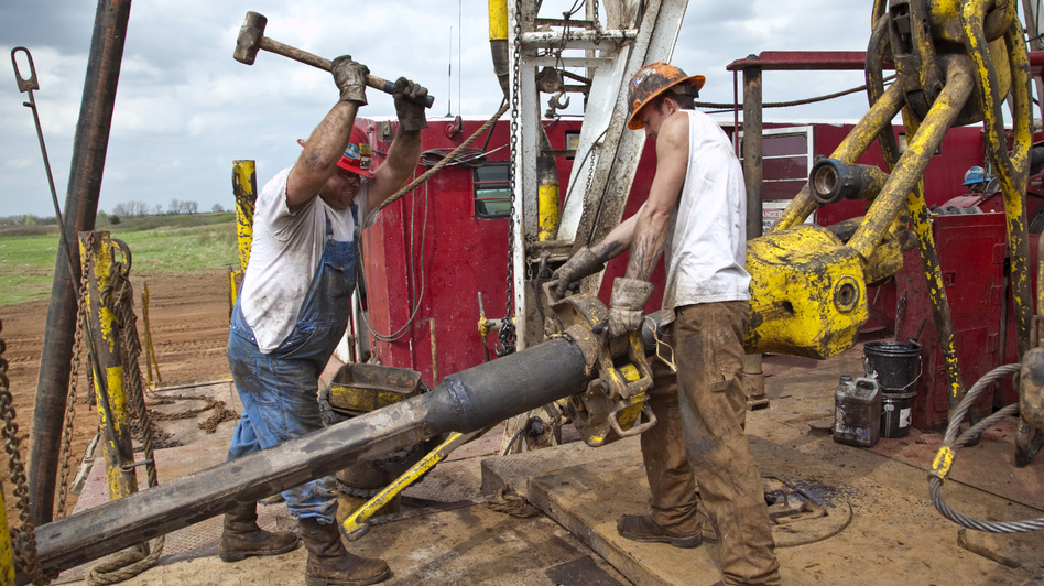 President Obama and Mitt Romney are both calling on the U.S. to become less dependent on foreign oil, though their plans differ. Here, workers with Bramwell Petroleum set up a derrick for a new oil well near Spivey, Kan., in March. (MCT/Landov)