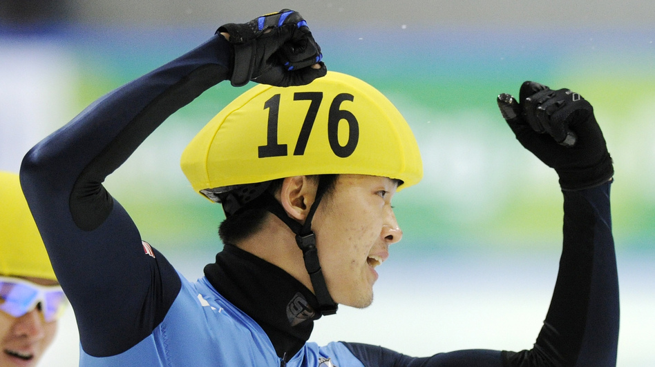 Simon Cho of the U.S. celebrates during the 500 meter men's final race at the Short Track Speed Skating World Cup in Dresden in 2011. (AP)