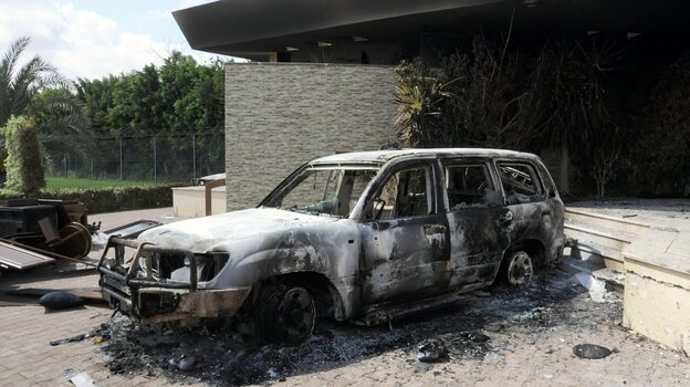U.S. authorities are investigating whether al-Qaida played a role in last month's attack on the U.S. Consulate in Benghazi. Here, a damaged vehicle sits outside the consulate one day after the attack. (EPA/Landov)