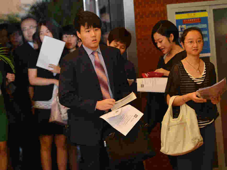 Unemployed Chinese graduates attend a career fair.