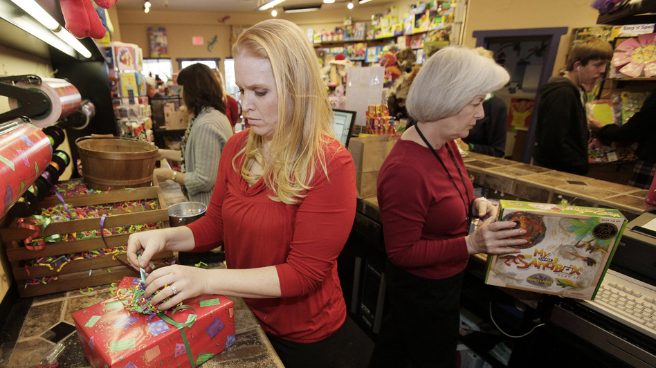 Retailers expect to hire hundreds of thousands of extra holiday workers this year, but the hours can be scarce — and unpredictable. (AP)