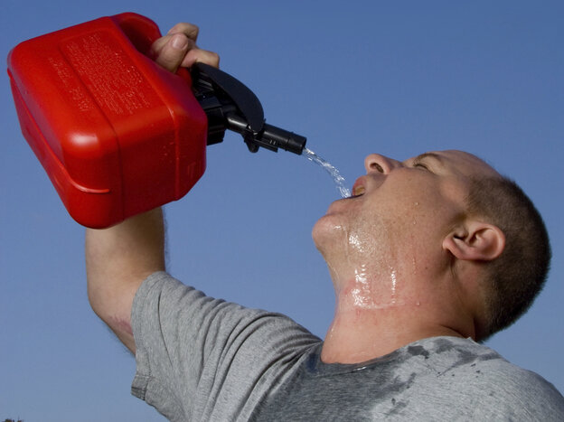 A man drinking gasoline from a gas can.