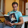 Matt Langione, a subject in the study, reads Jane Austen's Mansfield Park. Results from the study suggest that blood flow in the brain differs during leisurely and critical reading activities.