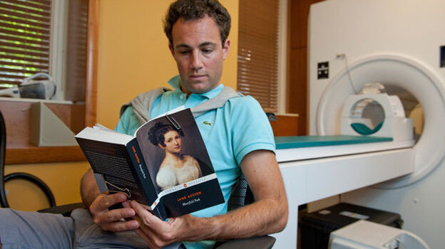 Matt Langione, a subject in the study, reads Jane Austen's Mansfield Park. Results from the study suggest that blood flow in the brain differs during leisurely and critical reading activities. (Stanford University)