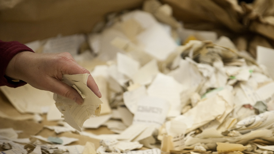 A worker in the former headquarters of the Stasi sorts hundreds of thousands of torn or shredded Stasi documents in January. Workers are sifting through thousands of bags, containing between 50,000 and 80,000 fragments each. (AFP/Getty Images)