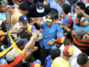 Venezuelan opposition presidential candidate Henrique Capriles Radonski (center) greets supporters during a campaign rally in Puerto Ayacucho on Oct. 1.