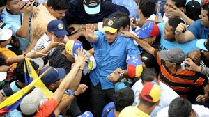 Venezuelan opposition candidate Henrique Capriles greets supporters during a campaign rally in Puerto Ayacucho.