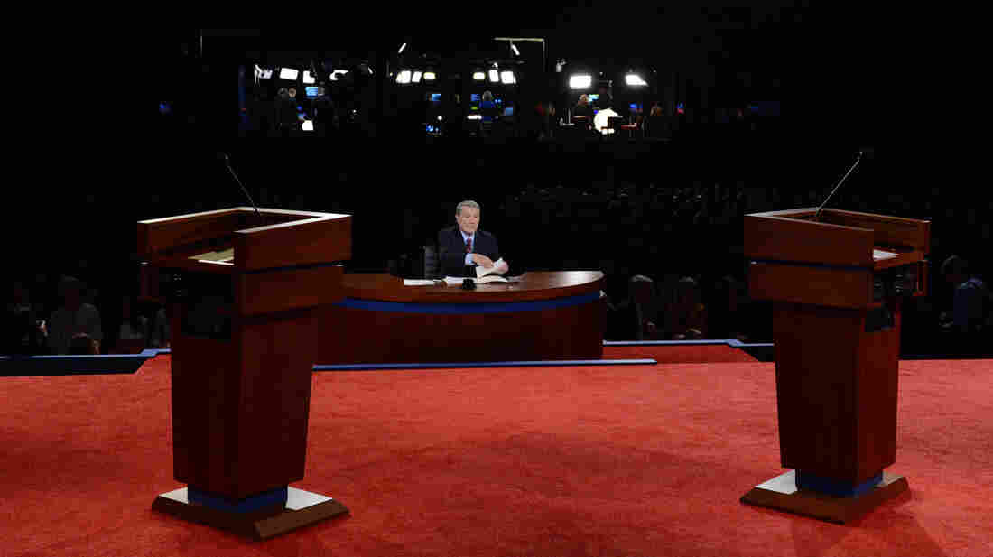 Moderator Jim Lehrer sits at his desk before last Wednesday's debate between President Obama and Republican presidential candidate Mitt Romney in Denver. For third-party candidates, getting into a presidential debate is practically impossible.