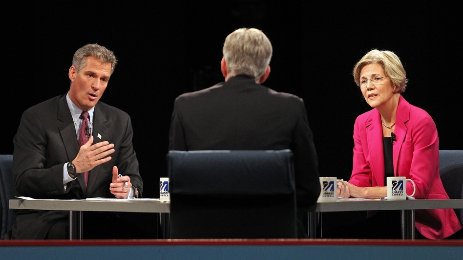 Republican U.S. Sen. Scott Brown (left) answers a question during a debate against Democratic challenger Elizabeth Warren on Monday at the University of Massachusetts in Lowell, Mass.