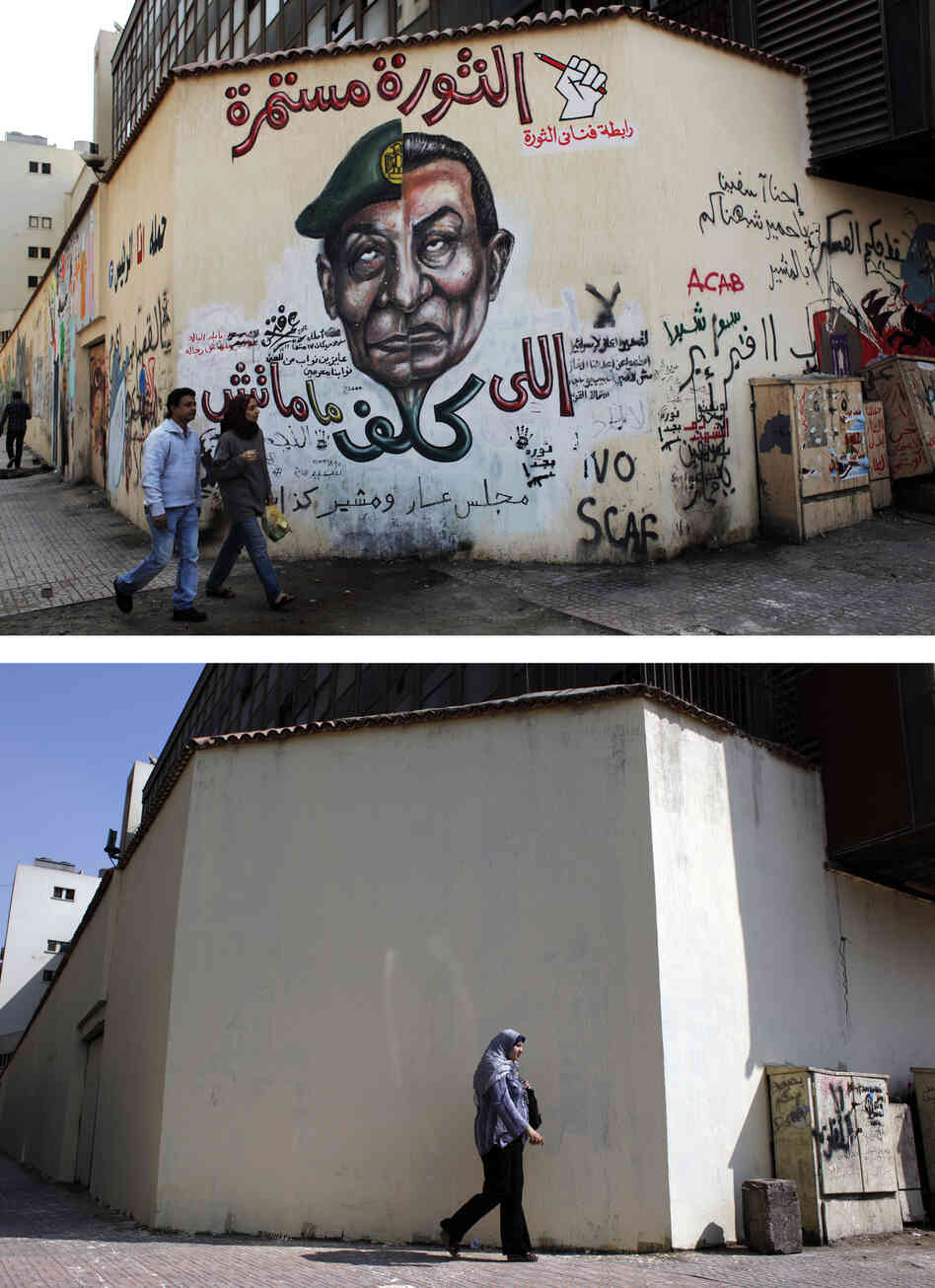 A mural (pictured above in March) was whitewashed (below) during a cleanup campaign in Cairo's Tahrir Square in September. Graffiti artists repainted the wall soon after.